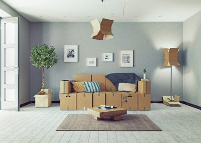 Furniture with cardboard boxes around it in a room
